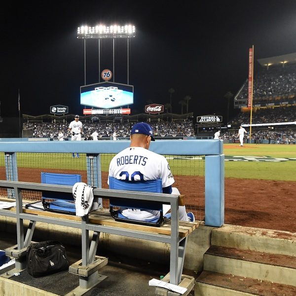 Manager Dave Roberts of the Los Angeles Dodgers sits in the dug out at Dodger Stadium on October 09, 2019. (Harry How/Getty Images)