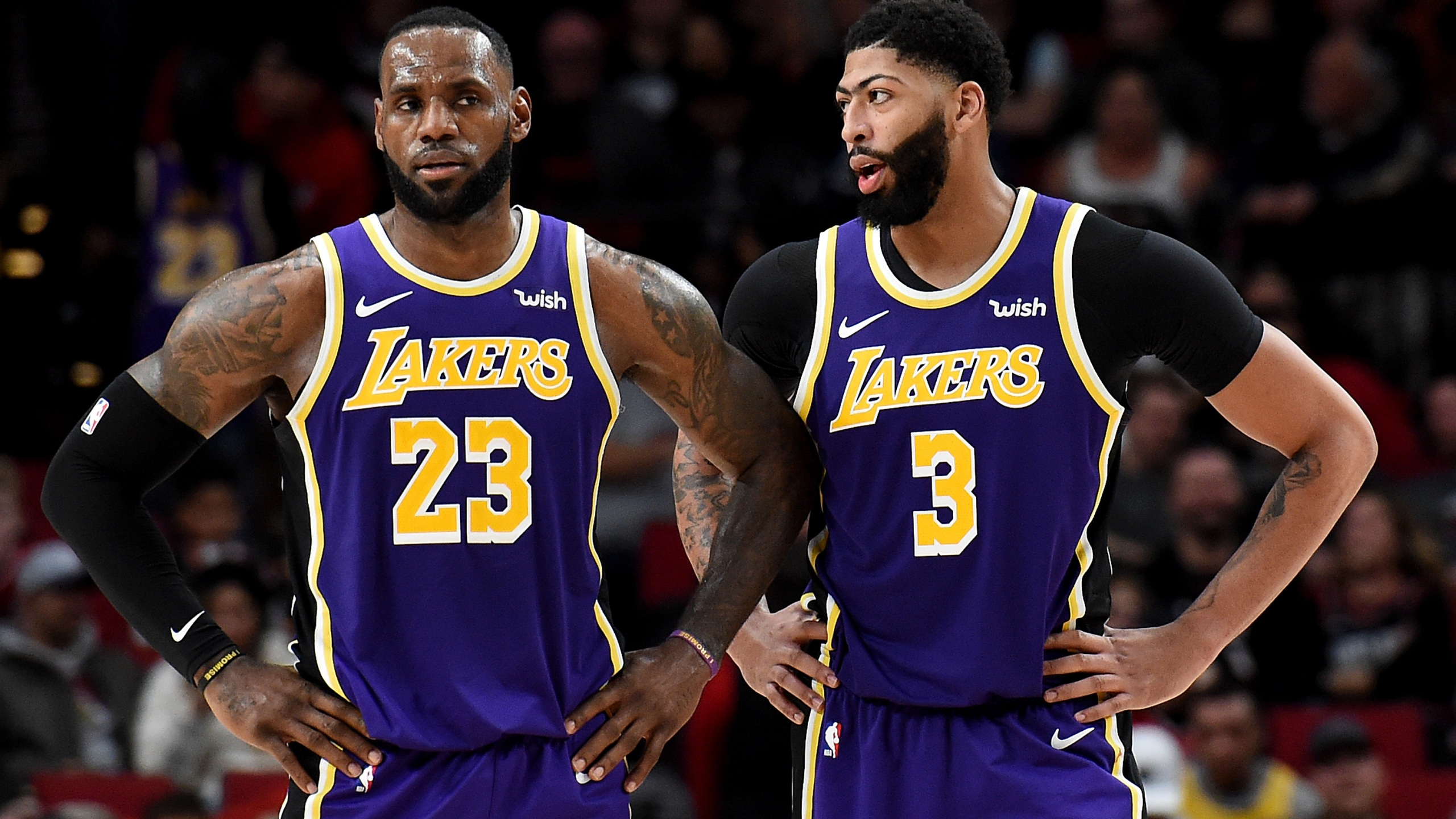 LeBron James and Anthony Davis of the Los Angeles Lakers speak during a time out in the second half of the game against the Portland Trail Blazers at Moda Center on December 06, 2019. (Steve Dykes/Getty Images)