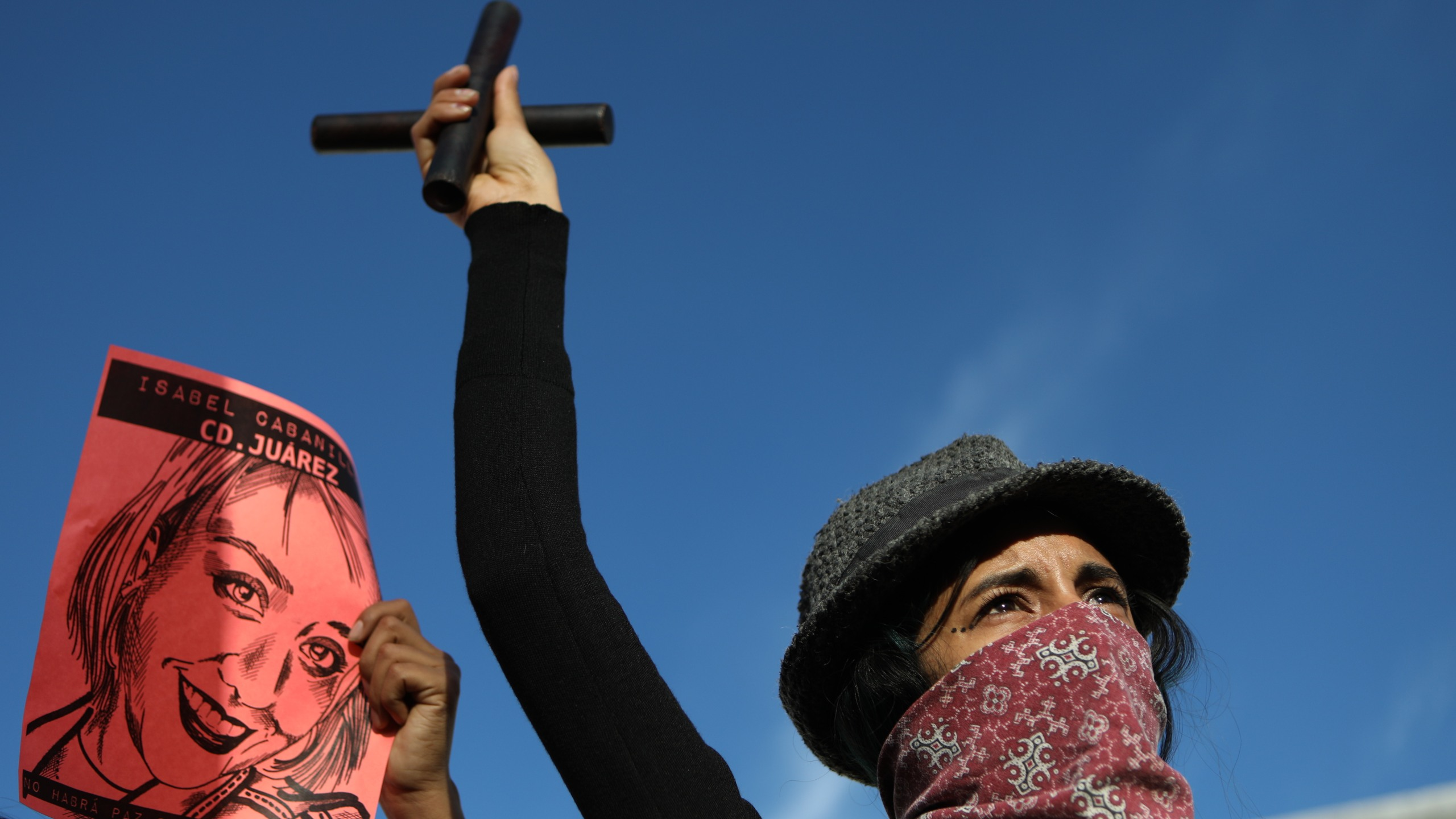 A woman gestures next to an image of slain 26-year-old artist, activist and feminist Isabel Cabanillas de la Torre as she joins demonstrators from Mexico and the U.S. to protest against femicides in Ciudad Juarez and Cabanillas de la Torre's murder, in Ciudad Juarez, in the state of Chihuahua, Mexico, on Jan. 25, 2020. (HERIKA MARTINEZ / AFP)