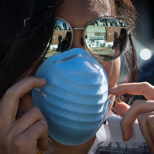 A student is seen wearing a face mask outside the UCLA campus in this file photo. (Credit: MARK RALSTON/AFP via Getty Images)