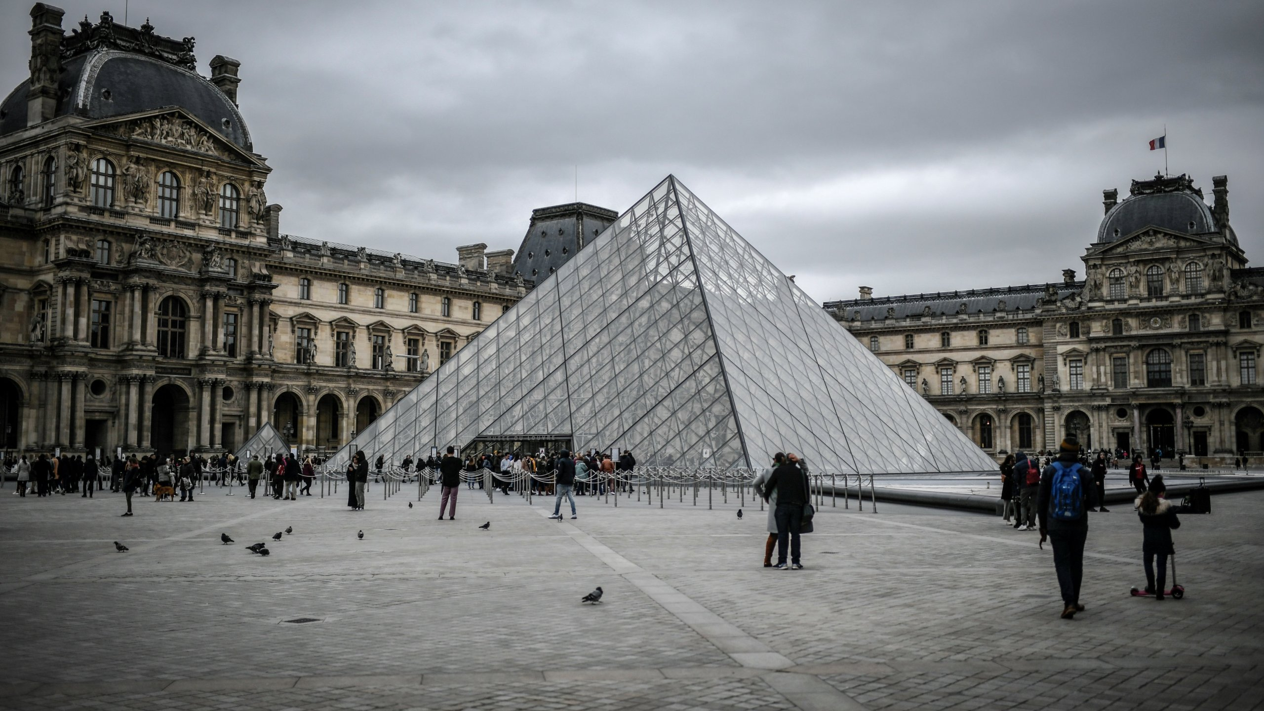 People visit the Louvre on Feb. 28, 2020 in Paris. (STEPHANE DE SAKUTIN/AFP via Getty Images)