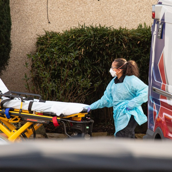 A health care worker prepares to transport a patient on a stretcher into an ambulance at Life Care Center of Kirkland on Feb. 29, 2020, in Kirkland, Washington. (David Ryder/Getty Images)
