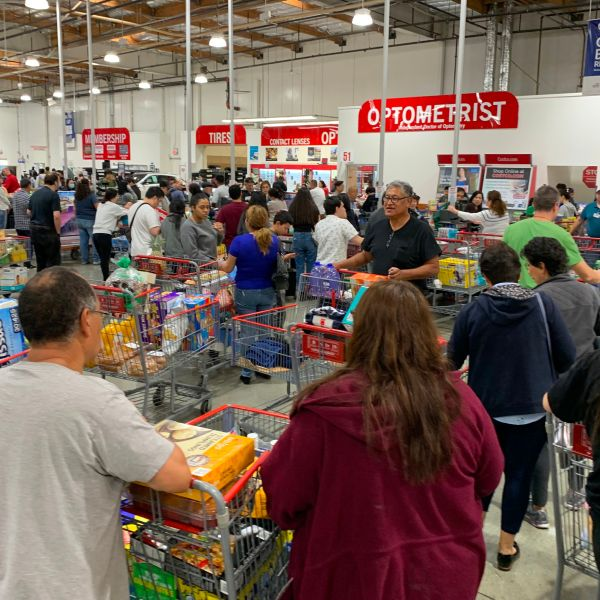 Shoppers buy toilet paper, food and water at a Los Angeles Costco, as people begin to panic buy and stockpile essentials from fear that supplies will be affected by the spread of the coronavirus. (MARK RALSTON/AFP via Getty Images)