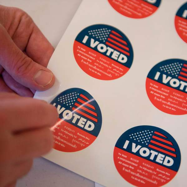 Voting stickers are displayed during early voting for the California primary in Los Angeles on March 1, 2020. (Credit: Mark Ralston / AFP / Getty Images)