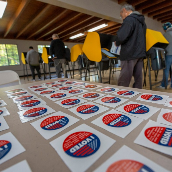 Voters cast their ballots at a voting center at Granada Park on March 3, 2020 in Alhambra. (David McNew/Getty Images)