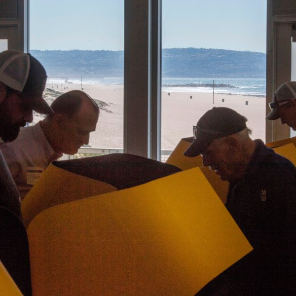 People vote at a beachside vote center in El Segundo during the presidential primary on Super Tuesday, March 3, 2020. (Credit: Mark Ralston / AFP / Getty Images)