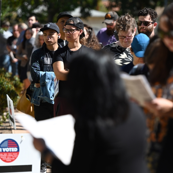 Voters wait in a long line to cast their ballot in the presidential primary at the Buena Vista Branch Library in Burbank on Super Tuesday, March 3, 2020. (Credit: Robyn Beck / AFP / Getty Images)