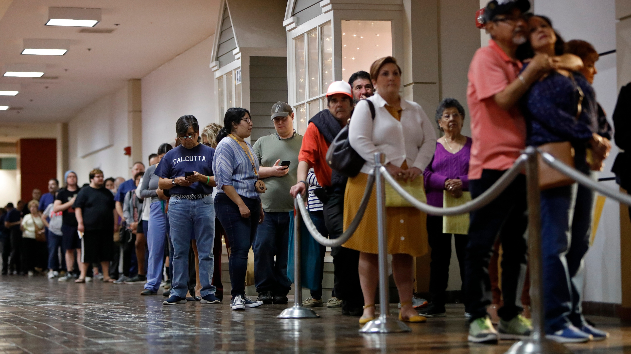 Voters wait in line to cast their ballots in San Antonio, Texas, on March 3, 2020. (Credit: Edward A. Ornelas / Getty Images)