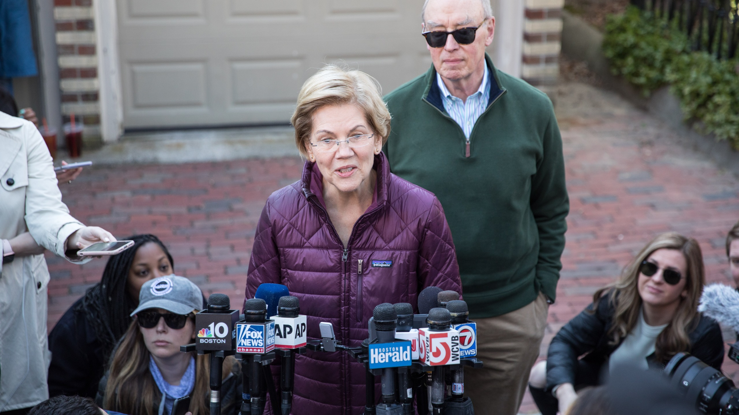 Sen. Elizabeth Warren (D-MA), with husband Bruce Mann, announces that she is dropping out of the presidential race during a media availability outside of her home on March 5, 2020 in Cambridge. (Scott Eisen/Getty Images)