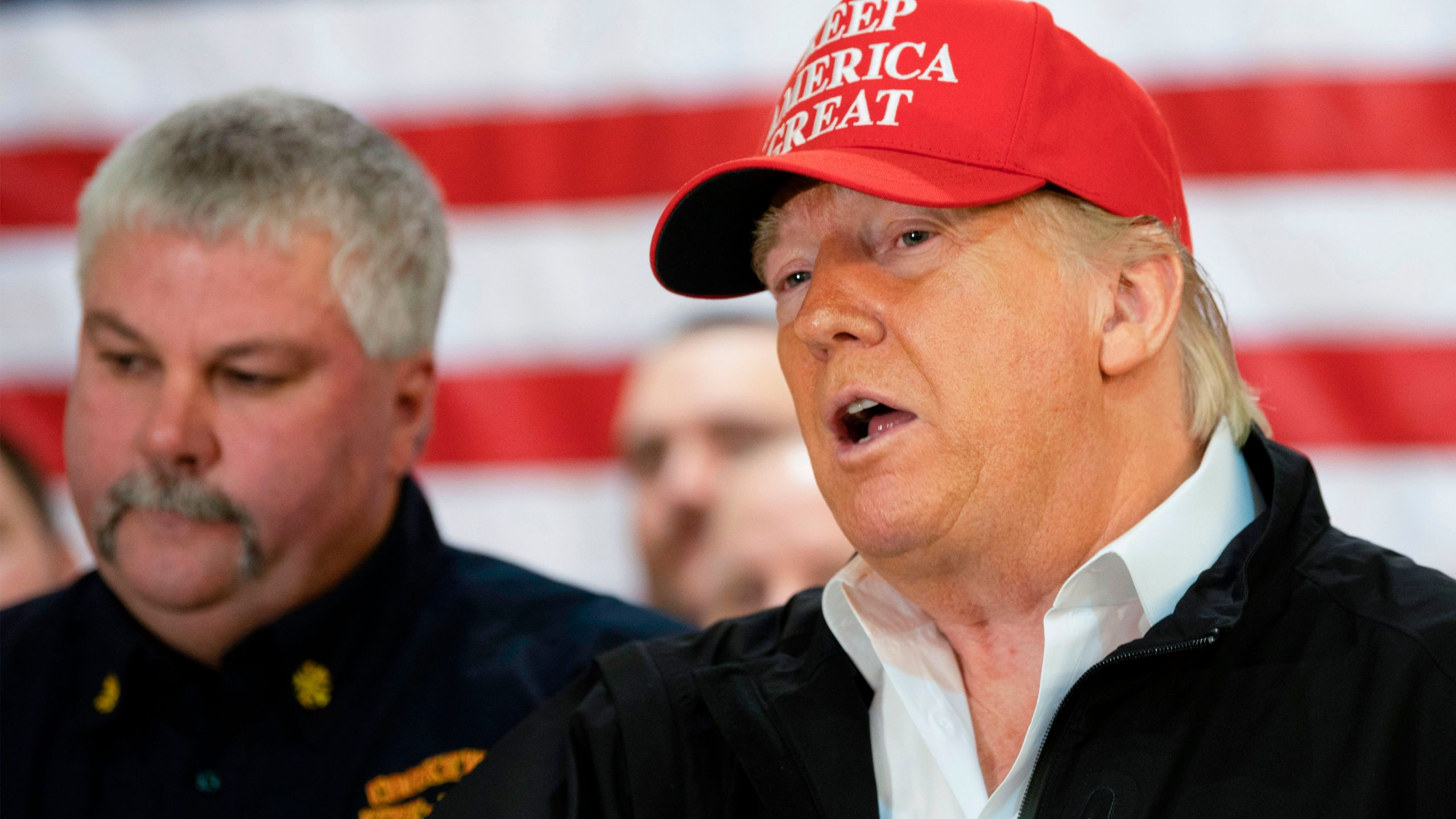 U.S. President Donald Trump talks with first responders at the Jefferson Avenue Church of Christ disaster relief distribution center after touring tornado damage in Cookeville, Tennessee, on March 6, 2020.(JIM WATSON/AFP via Getty Images)