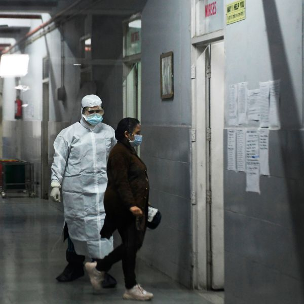 """Members of medical staff are seen inside an insloation ward for COVID-19 coronavirus, at Guru Nanak Dev hospital in Amritsar, India, on March 7, 2020. The World Health Organization called the spread of the virus """"deeply concerning"""" as a wave of countries reported their first cases of the disease. (NARINDER NANU/AFP via Getty Images)"""