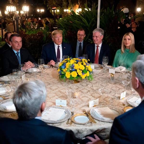 President Donald Trump (C) speaks with Brazilian President Jair Bolsonaro (L), alongside United States National Security Advisor Robert O'Brien (3rd R), Advisor to the President Ivanka Trump (2nd R) and Senior Advisor Jared Kushner (R), during a diner at Mar-a-Lago in Palm Beach, Florida, on March 7, 2020. (JIM WATSON/AFP via Getty Images)