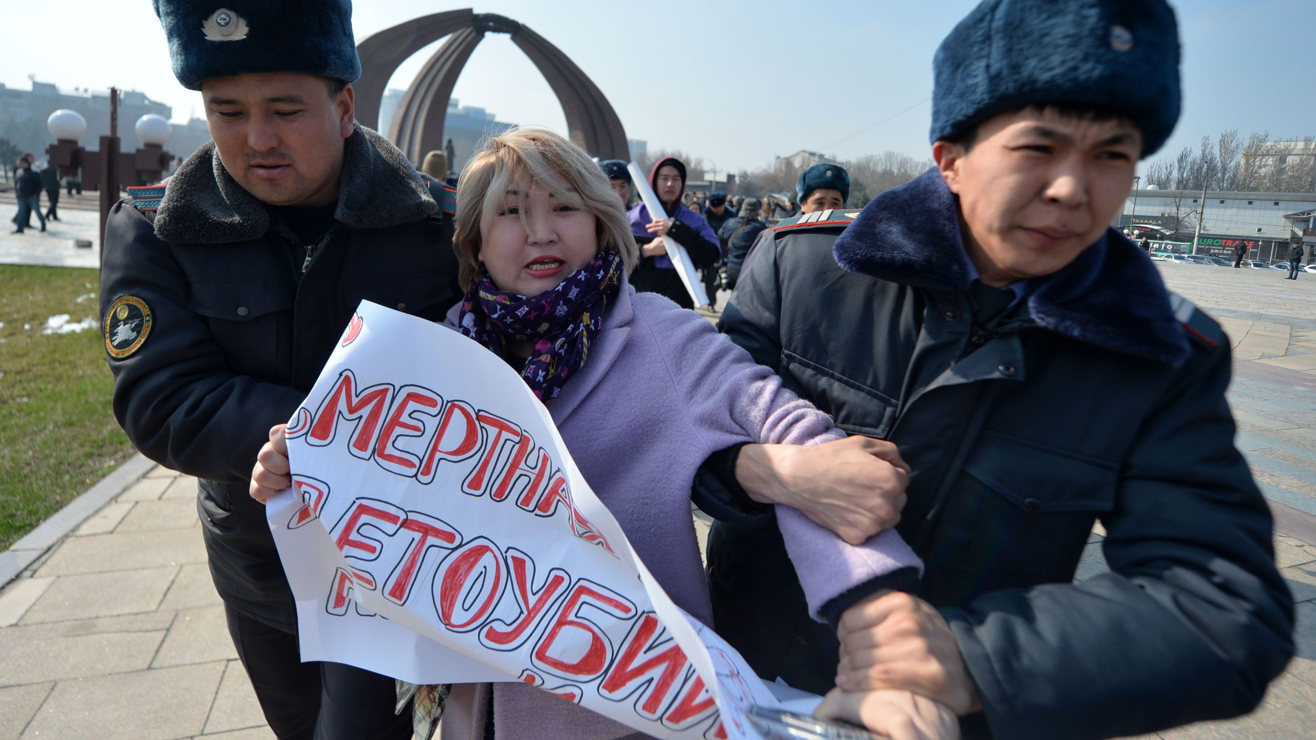 Kyrgyz police arrest a woman protesting against gender-based violence to mark International Women's Day in Bishkek on March 8, 2020. (VYACHESLAV OSELEDKO/AFP via Getty Images)