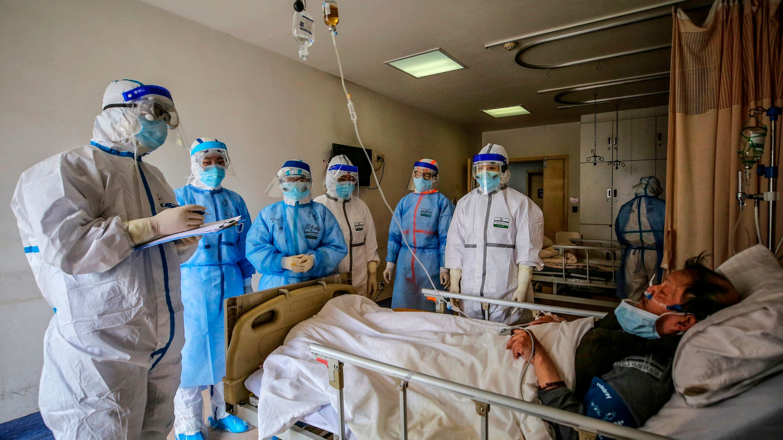 Medical staff speak with a COVID-19 patient at Red Cross Hospital in Wuhan, China, on March 10, 2020. (STR/AFP via Getty Images)