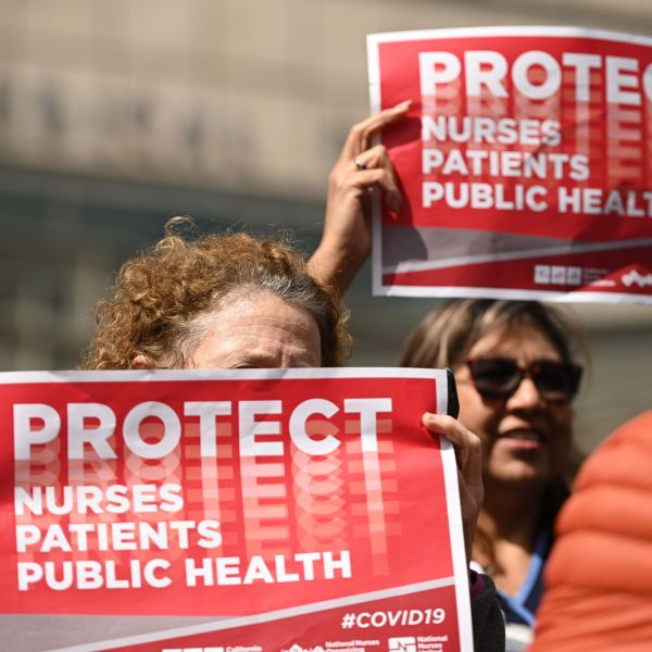 Nurses protest to oppose what they call the Center for Disease Control's weak response to the novel coronavirus, n March 11, 2020, outside the UCLA Medical Center in Los Angeles. (ROBYN BECK/AFP via Getty Images)