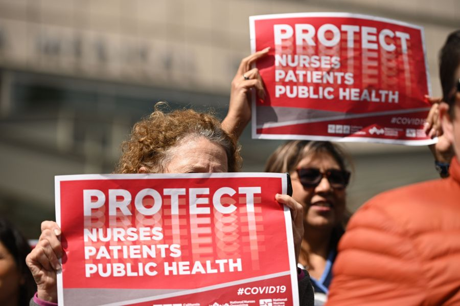 Nurses protest to oppose what they call the Center for Disease Control's weak response to the novel coronavirus, n March 11, 2020 outside the UCLA Medical Center in Los Angeles. (ROBYN BECK/AFP via Getty Images)