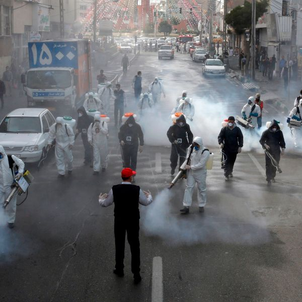 Iranian Firefighters disinfect streets in the capital Tehran in a bid to halt the wild spread of coronavirus on March 13 2020.(AFP via Getty Images)