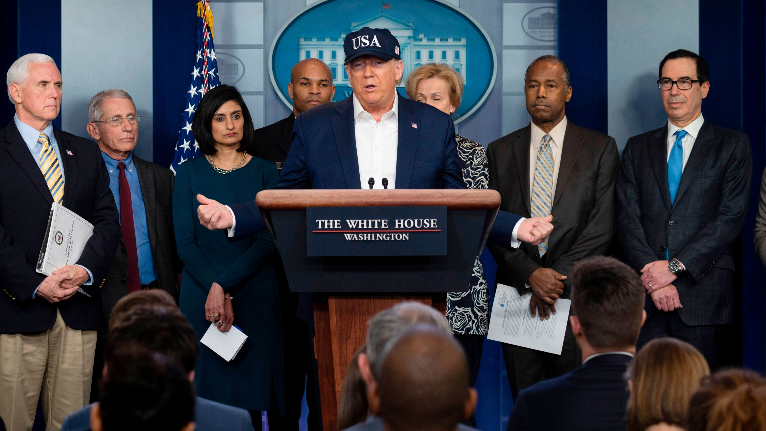 Donald Trump gives a press briefing about the coronavirus outbreak alongside members of the White House coronavirus task force at the White House on March 14, 2020. (JIM WATSON/AFP via Getty Images)