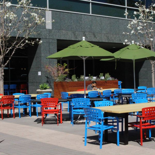 A Google employee eats alone in the sun at lunch time on March 12, 2020, at the company's main campus in the Silicon Valley city of Mountain View, Calif. (GLENN CHAPMAN/AFP via Getty Images)