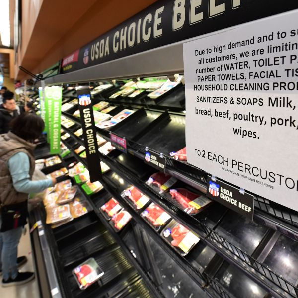 A sign announces a two-item limit for certain items as people shop for food at a Ralph's Supermarket in Monterey Park, Calif. on March 16, 2020, as the Coronavirus pandemic brings much of California to a standstill. (FREDERIC J. BROWN/AFP via Getty Images)