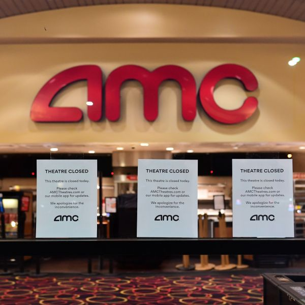 """Theater Closed"" signs are posted in front of the AMC Montebello, as the U.S. chain of AMC movie theaters closes on March 17, 2020. (FREDERIC J. BROWN/AFP via Getty Images)"