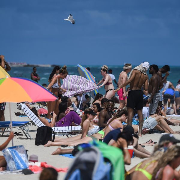 People enjoy the water in Miami Beach, Fla., on March 18, 2020. (CHANDAN KHANNA/AFP via Getty Images)