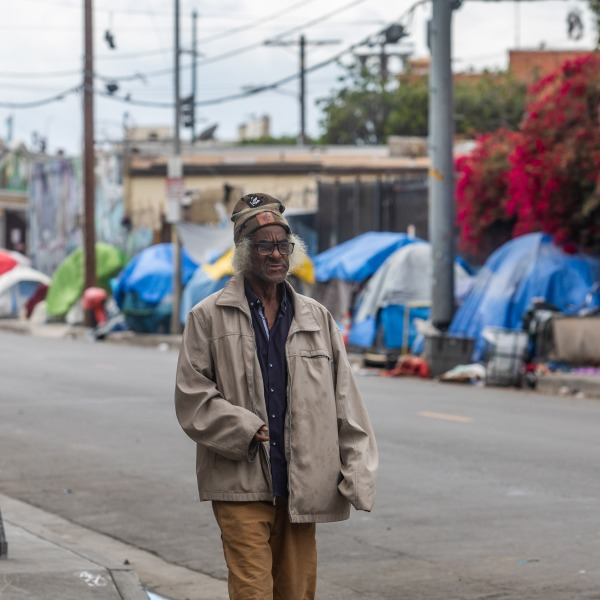 A homeless person walks on San Julian Street in the Skid Row area in downtown Los Angeles on March 19, 2020. (APU GOMES/AFP via Getty Images)