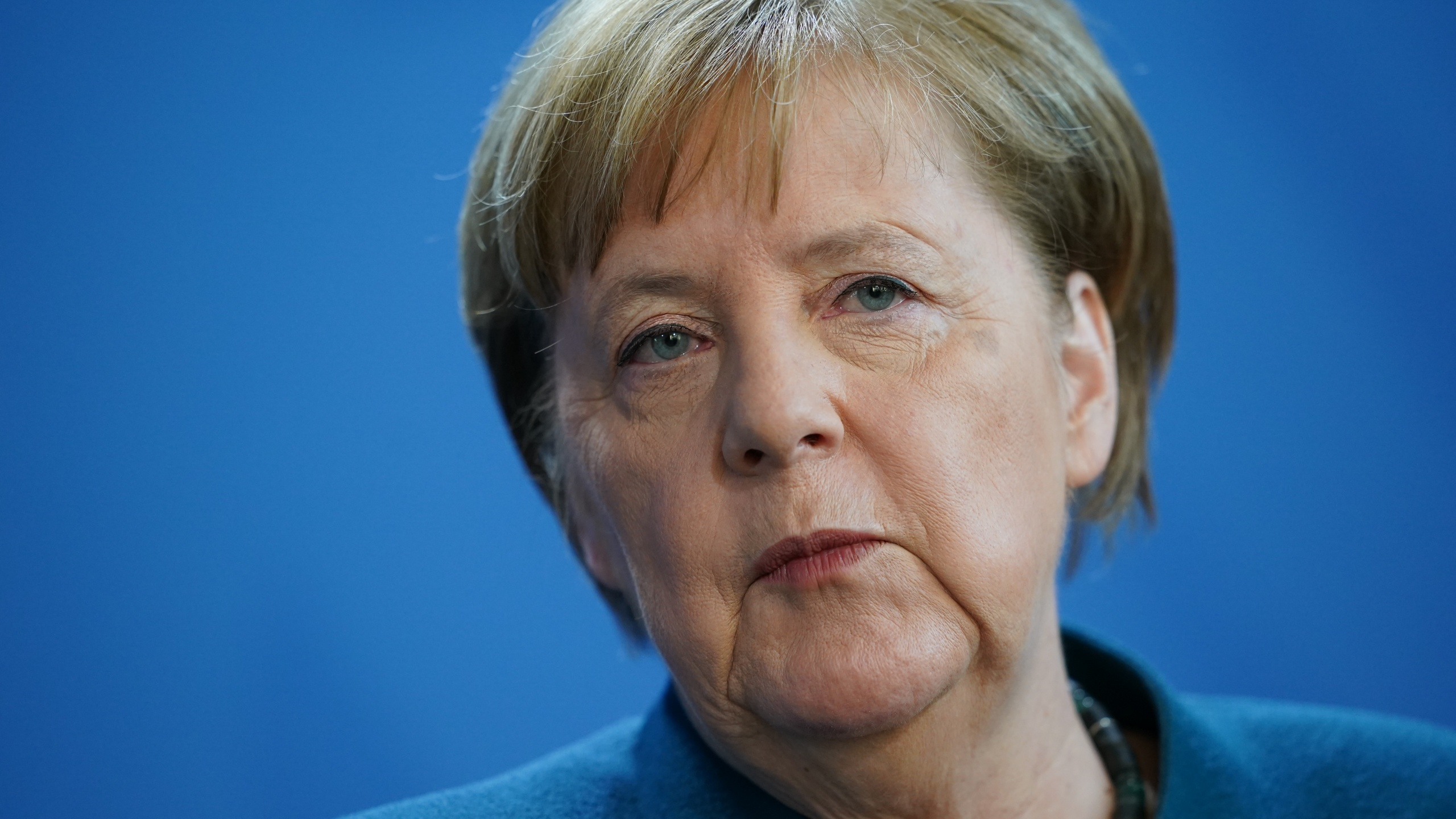 German Chancellor Angela Merkel speaks to reporters to announce further measures to combat the spread of the coronavirus and COVID-19, the disease the virus causes, after she held a teleconference with the governors of Germany's 16 states on March 22, 2020, in Berlin, Germany. (Clemens Bilan - Pool/Getty Images)