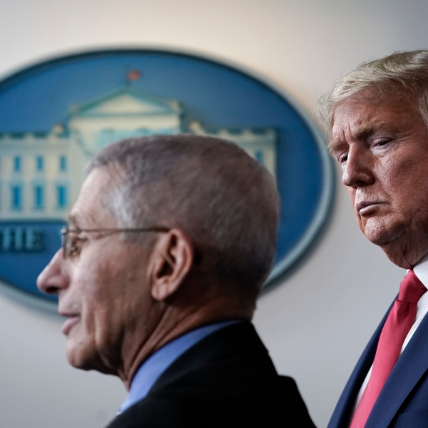 Dr. Anthony Fauci, director of the National Institute of Allergy and Infectious Diseases, speaks as President Donald Trump looks on during a briefing on the coronavirus pandemic, in the press briefing room of the White House on March 24, 2020. (Drew Angerer/Getty Images)
