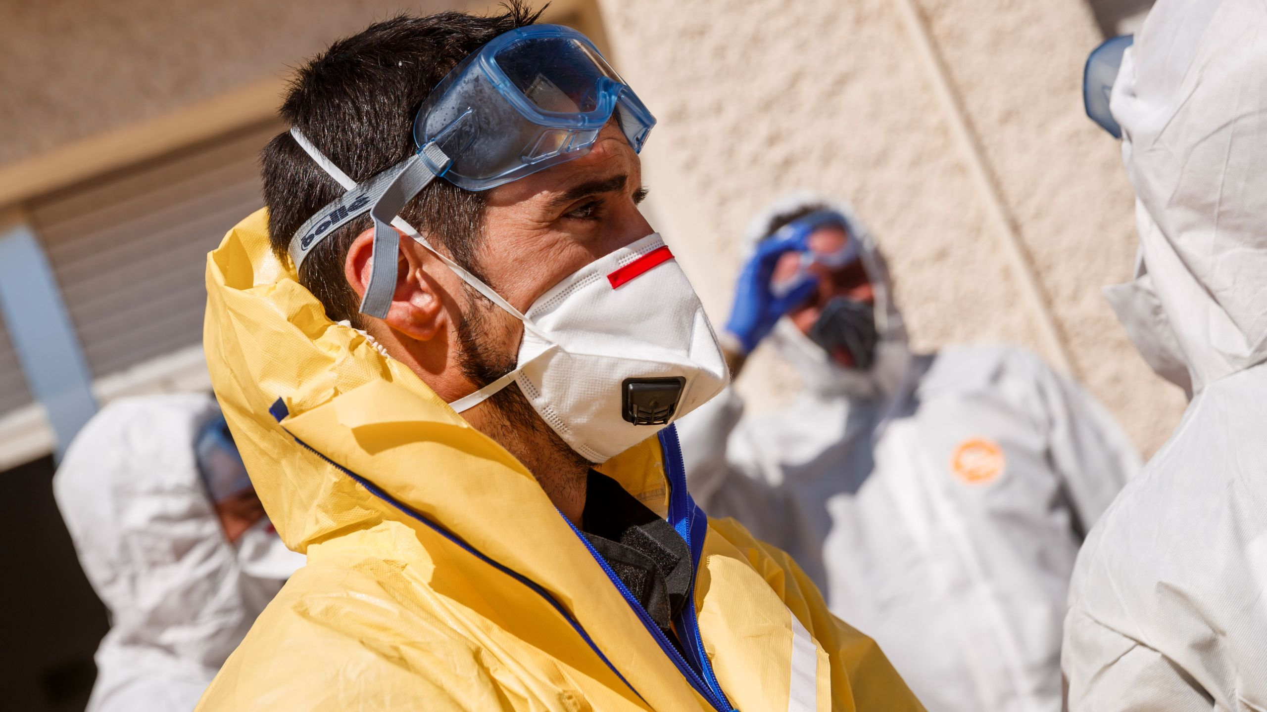 Members of the Military Emergencies Unit (UME) carry out a general disinfection at the Apanid residence for people with physical and intellectual disabilities of all ages in the Getafe suburb of Madrid on March 25, 2020, amid a national lockdown to fight the spread of the COVID-19 coronavirus. (BALDESCA SAMPER/AFP via Getty Images)