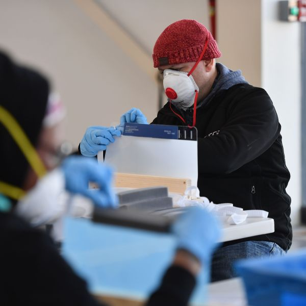 People work in the Brooklyn Navy Yard in New York City, where local industrial firms have begun manufacturing personal protective equipment like face shields, on March 26, 2020. (Credit: Angela Weiss / AFP / Getty Images)