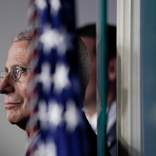 National Institute of Allergy and Infectious Diseases Director Dr. Anthony Fauci listens as U.S. President Donald Trump speaks during a briefing on the coronavirus pandemic, in the press briefing room of the White House on March 26, 2020 in Washington, D.C. (Drew Angerer/Getty Images)