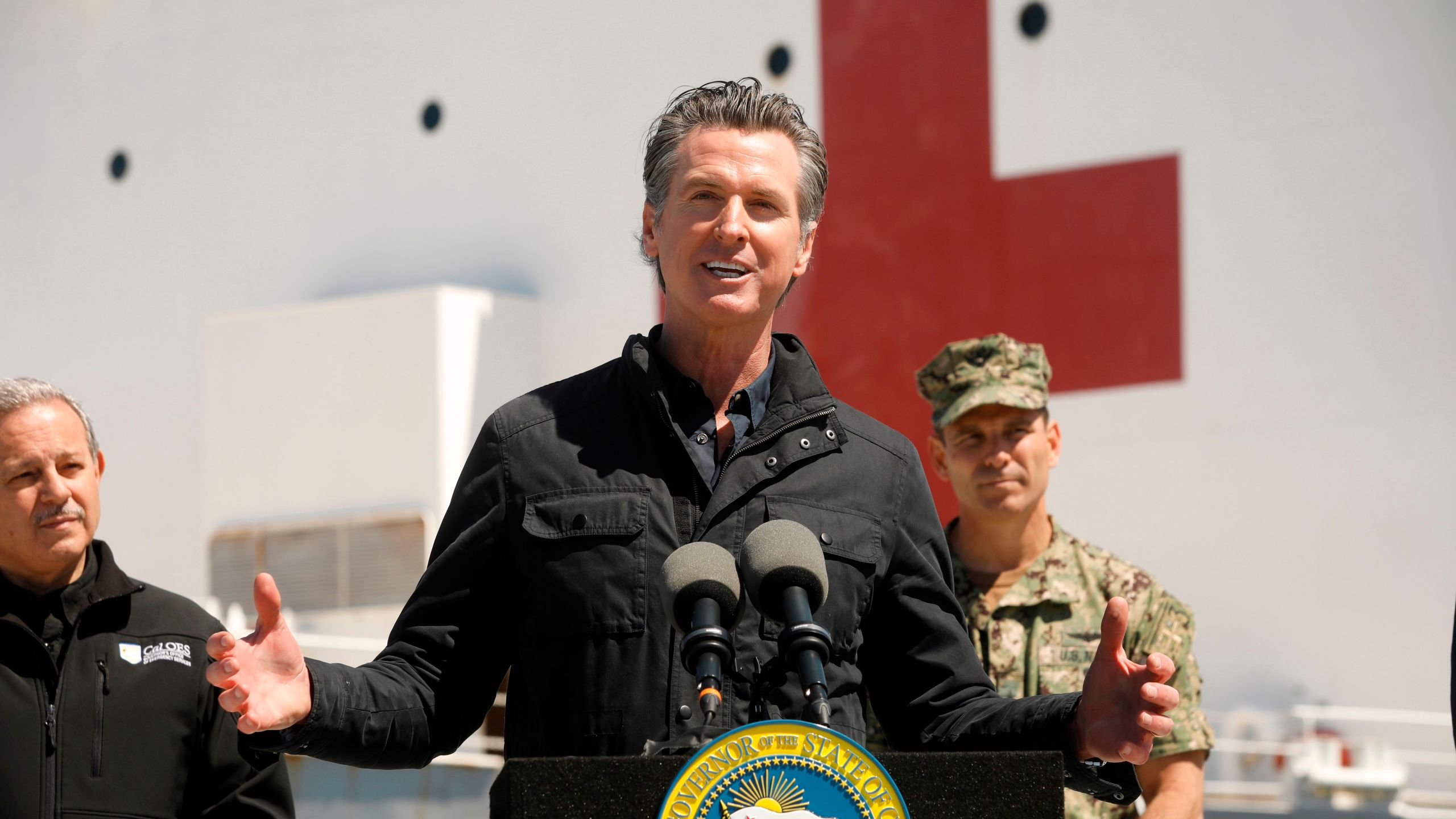 California Governor Gavin Newsom speaks in front of the hospital ship USNS Mercy after it arrived into the Port of Los Angeles on March 27, 2020.(Carolyn Cole/POOL/AFP via Getty Images)