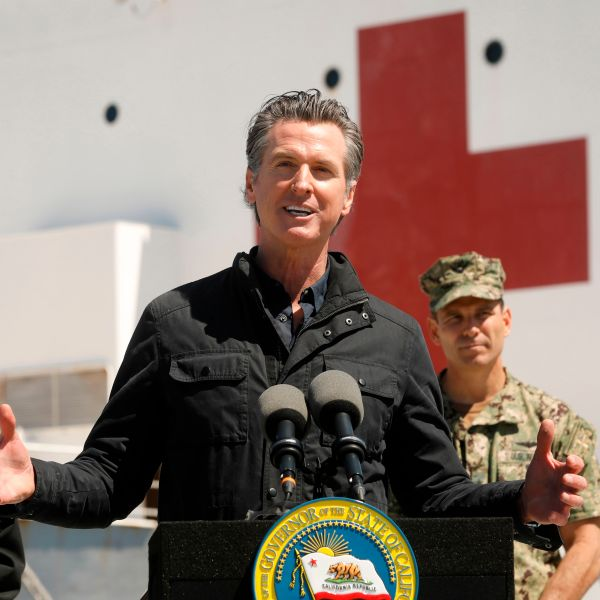 California Gov. Gavin Newsom speaks in front of the hospital ship USNS Mercy after it arrived into the Port of Los Angeles on March 27, 2020. (Carolyn Cole/POOL/AFP via Getty Images)