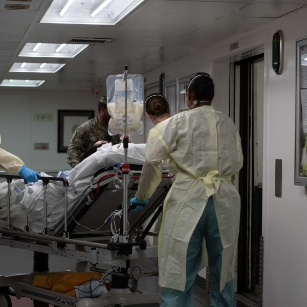 In this handout released by the U.S. Navy, Sailors assigned to the hospital ship USNS Mercy transport the first patient from Los Angeles medical facilities March 29, 2020. Mercy was deployed in support of the nation's COVID-19 response efforts, and will serve as a referral hospital for non-COVID-19 patients currently admitted to shore-based hospitals. This allows other hospitals to focus their efforts on COVID-19 cases. (U.S. Navy via Getty Images)
