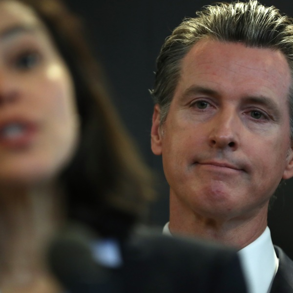 California Gov. Gavin Newsom looks on as California Department of Public Health Director Dr. Sonia Angell speaks during a news conference in Sacramento on Feb. 27, 2020. (Credit: Justin Sullivan / Getty Images)