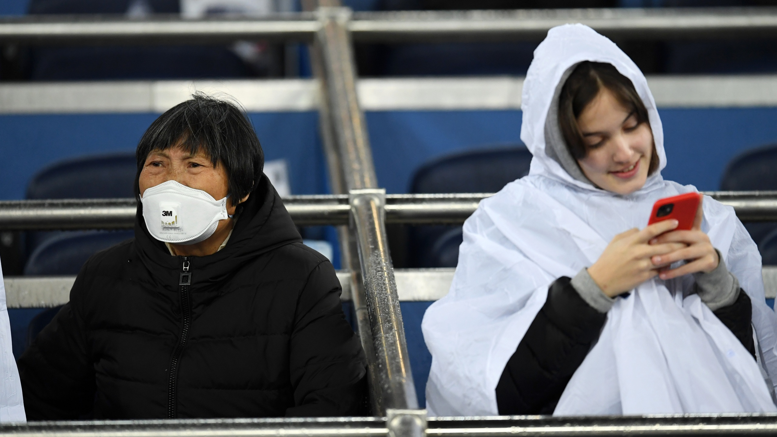 A fan wears a 3M Aura Disposable Respirator as they await kickoff prior to the Liga match between Real Madrid CF and FC Barcelona at Estadio Santiago Bernabeu on March 1, 2020 in Madrid, Spain. (David Ramos/Getty Images)