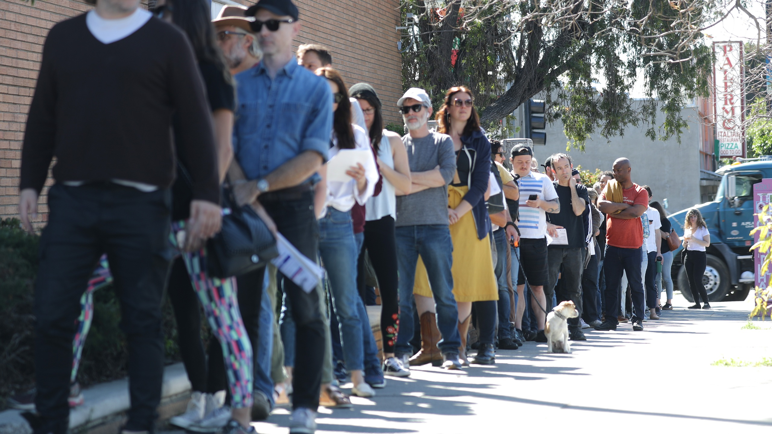 Voters wait in line to cast their ballots at a vote center at a Masonic Lodge in Los Angeles on March 3, 2020. (Mario Tama/Getty Images)