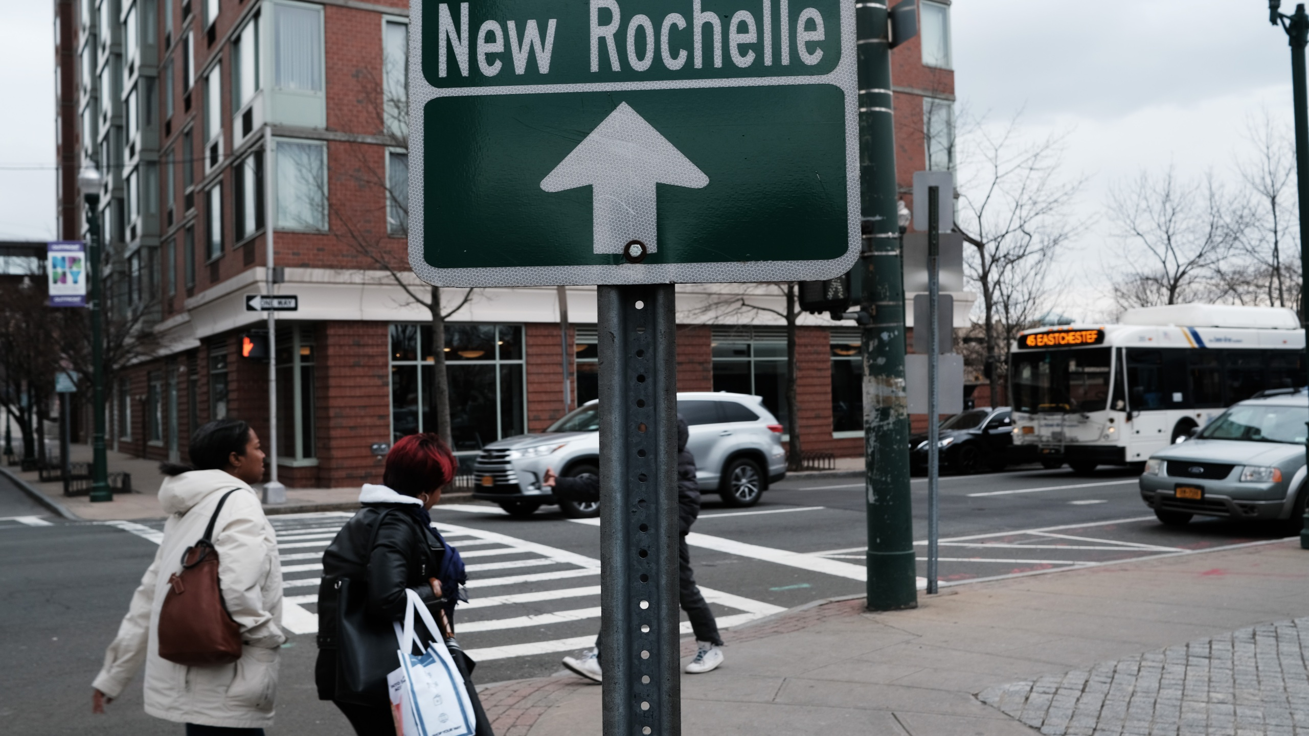 People walk through downtown on March 10, 2020 in New Rochelle, New York. (Credit: Spencer Platt/Getty Images)
