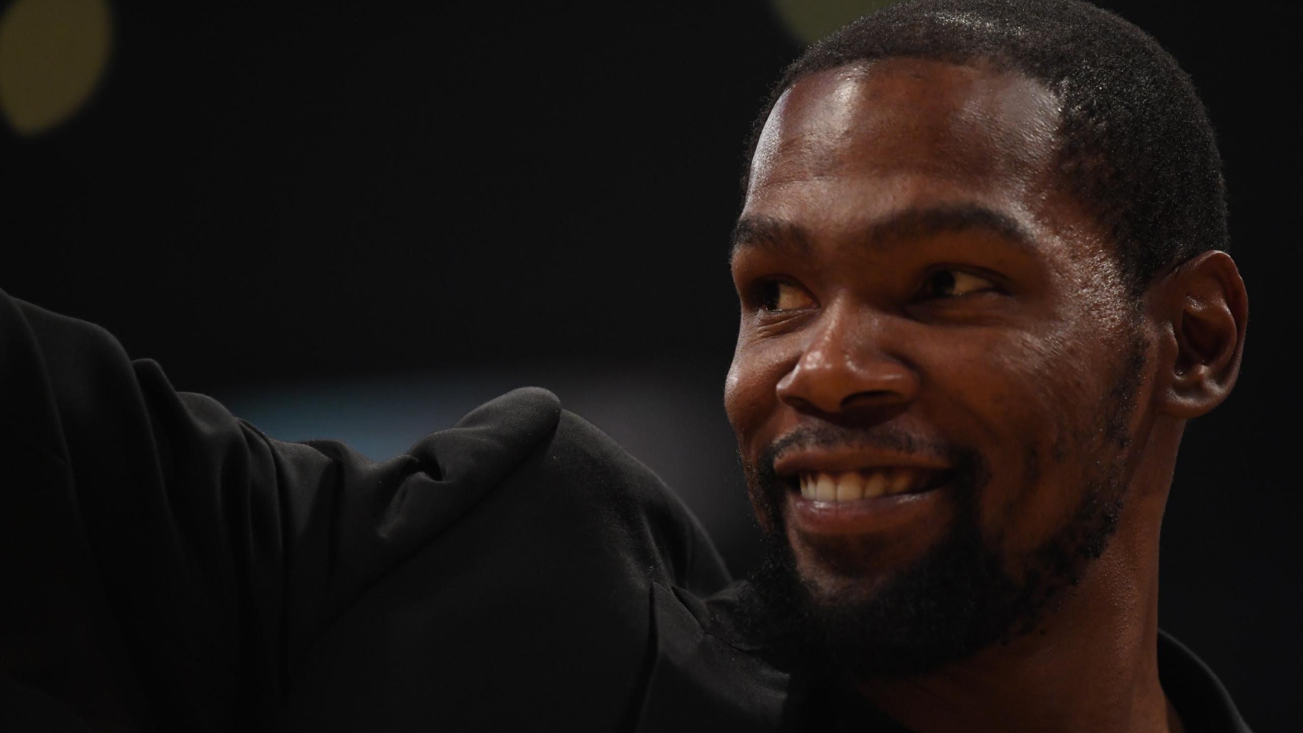 Kevin Durant of the Brooklyn Nets, sidelined by injury, smiles during a game against the Los Angeles Lakers at Staples Center on March 10, 2020. (Credit: Harry How / Getty Images)
