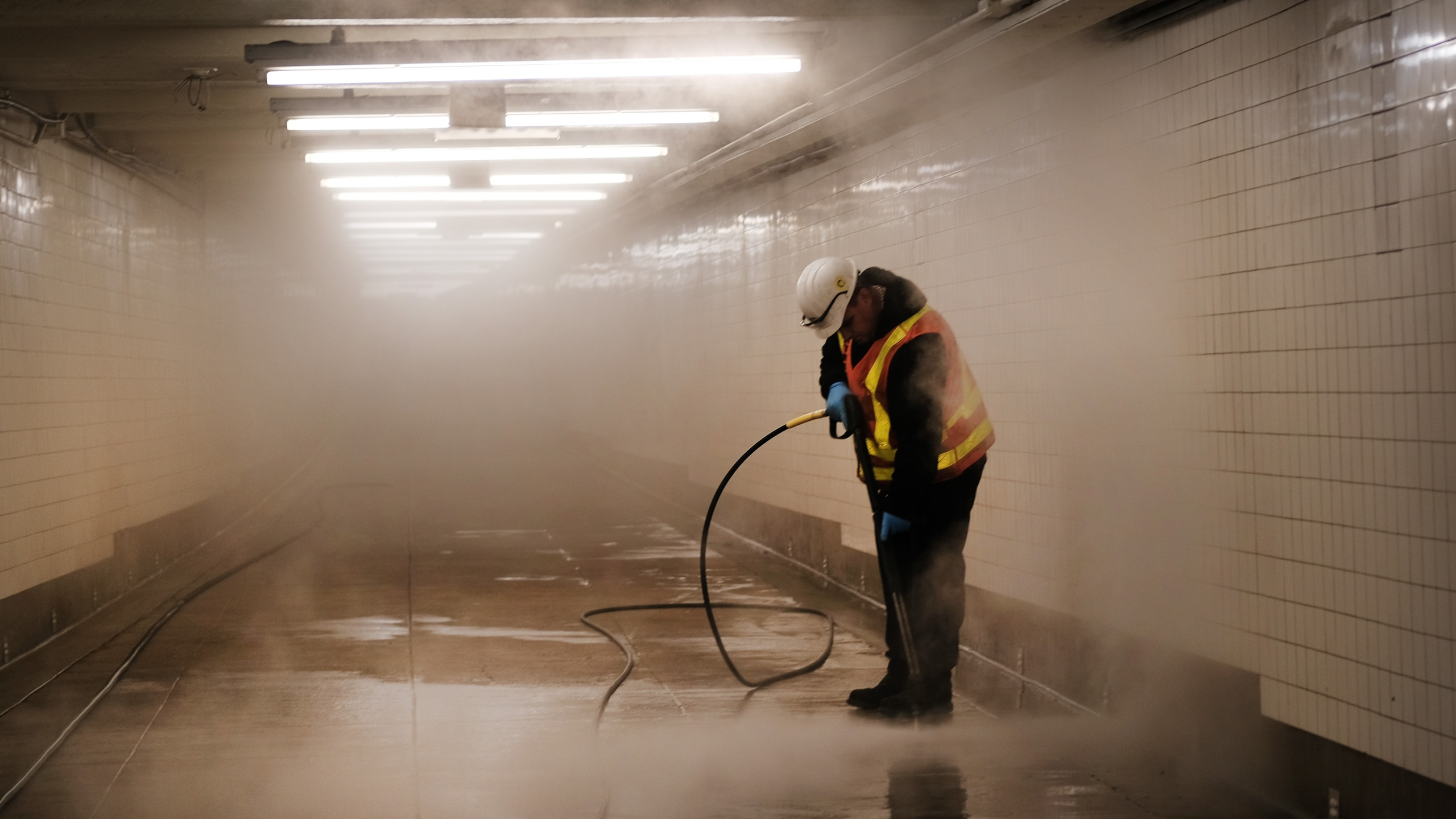 Workers clean a subway station in Brooklyn as New York City confronts the coronavirus outbreak on March 11, 2020. (Spencer Platt/Getty Images)
