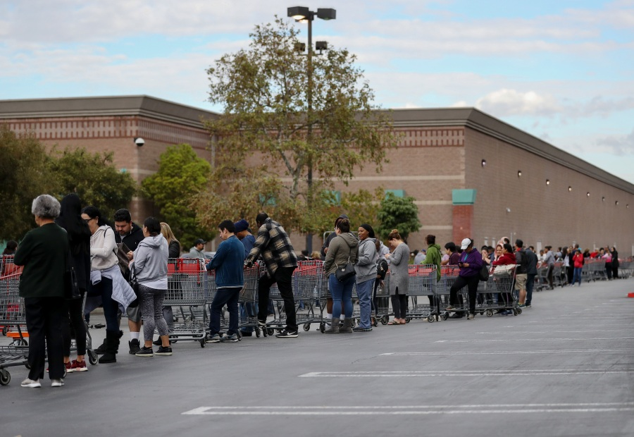 People wait in line to enter a Costco Wholesale store before it opened in the morning on March 12, 2020 in Glendale. (Mario Tama/Getty Images)