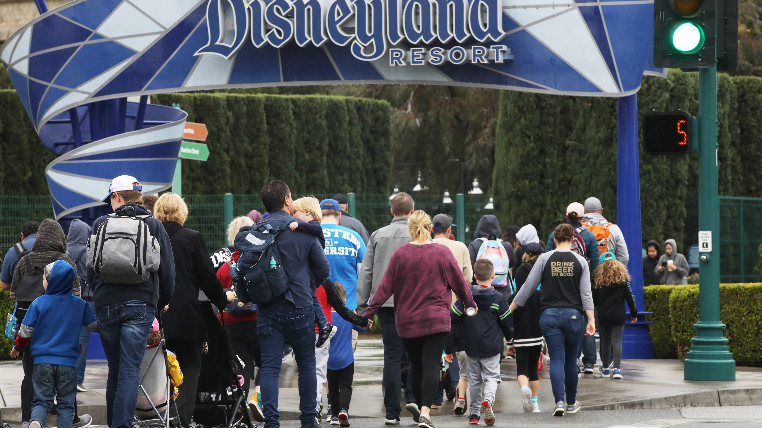 Disneyland visitors enter the famed amusement park in Anaheim on March 13, 2020. (Credit: Mario Tama / Getty Images)
