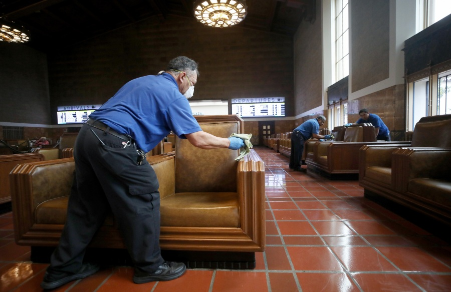 Seats in a waiting area are cleaned by custodial staff at Union Station on March 13, 2020 in Los Angeles. (Mario Tama/Getty Images)