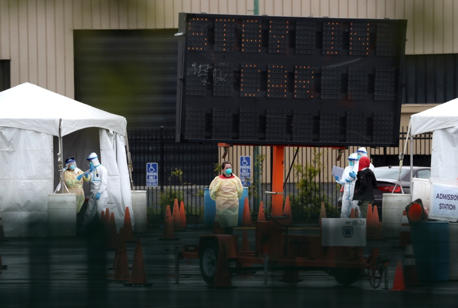 Medical personnel set up a coronavirus drive-thru test clinic at the San Mateo County Event Center on March 16, 2020 in San Mateo. (Justin Sullivan/Getty Images)