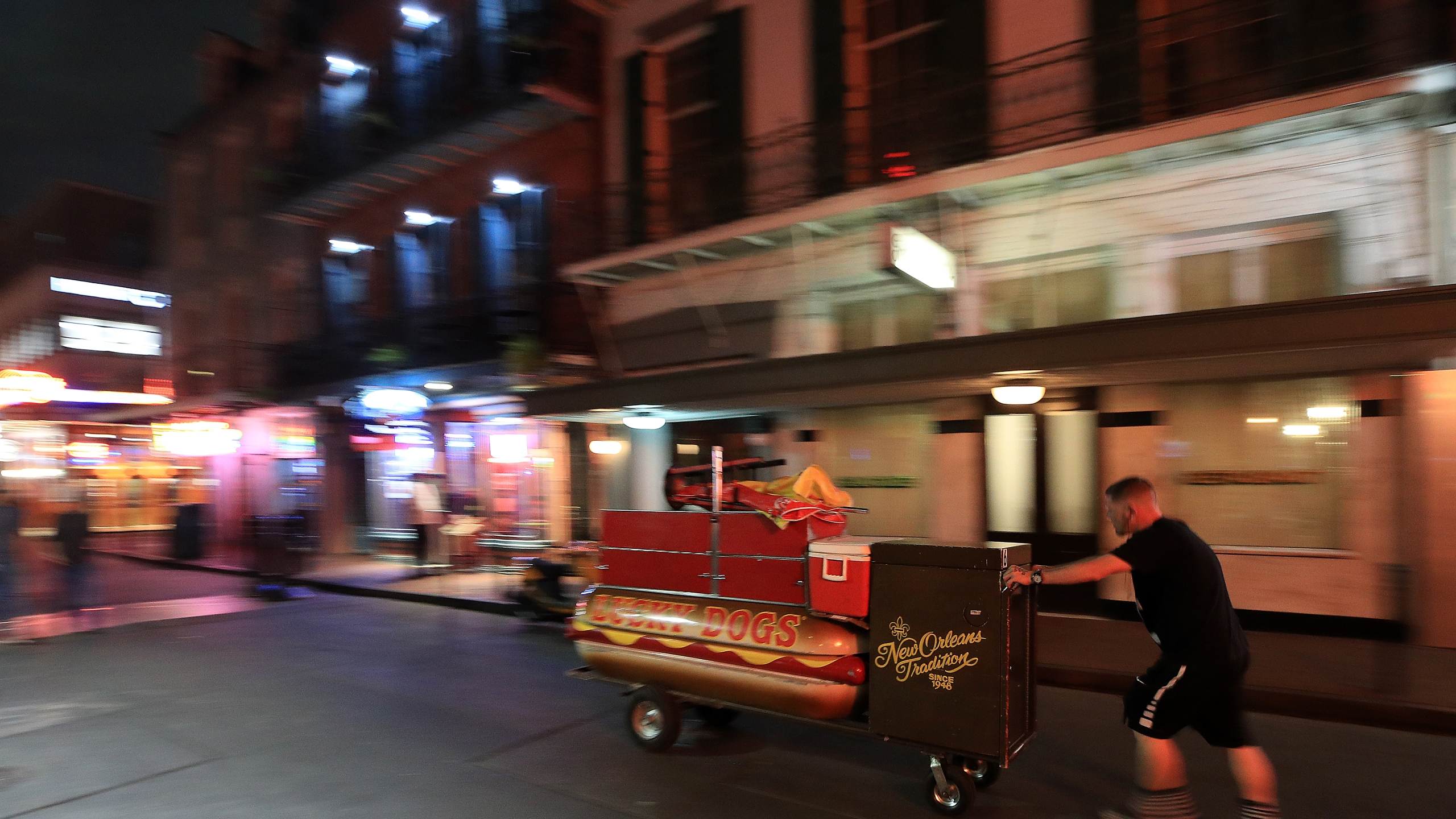 A Lucky Dog vendor leaves Bourbon Street as Louisiana Governor John Bel Edwards orders bars, gyms and casinos to close until April 13th due to the spread of coronavirus on March 16, 2020, in New Orleans, Louisiana. (Chris Graythen/Getty Images)