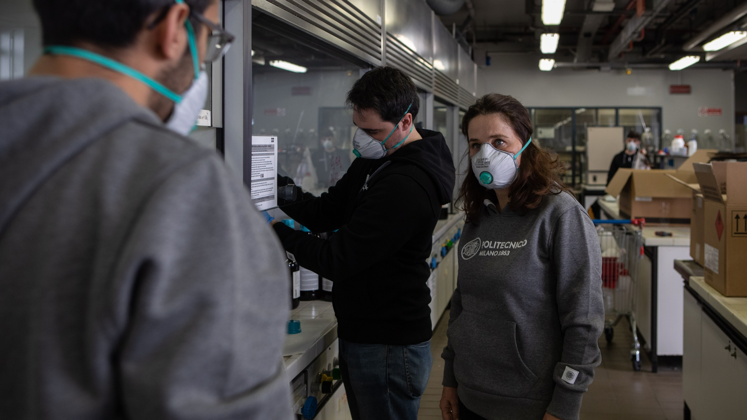 Professor MariaPia Pedeferri talks to a PhD student inside the Department laboratory at Politecnico di Milano on March 19, 2020, in Milan, Italy. (Emanuele Cremaschi/Getty Images)
