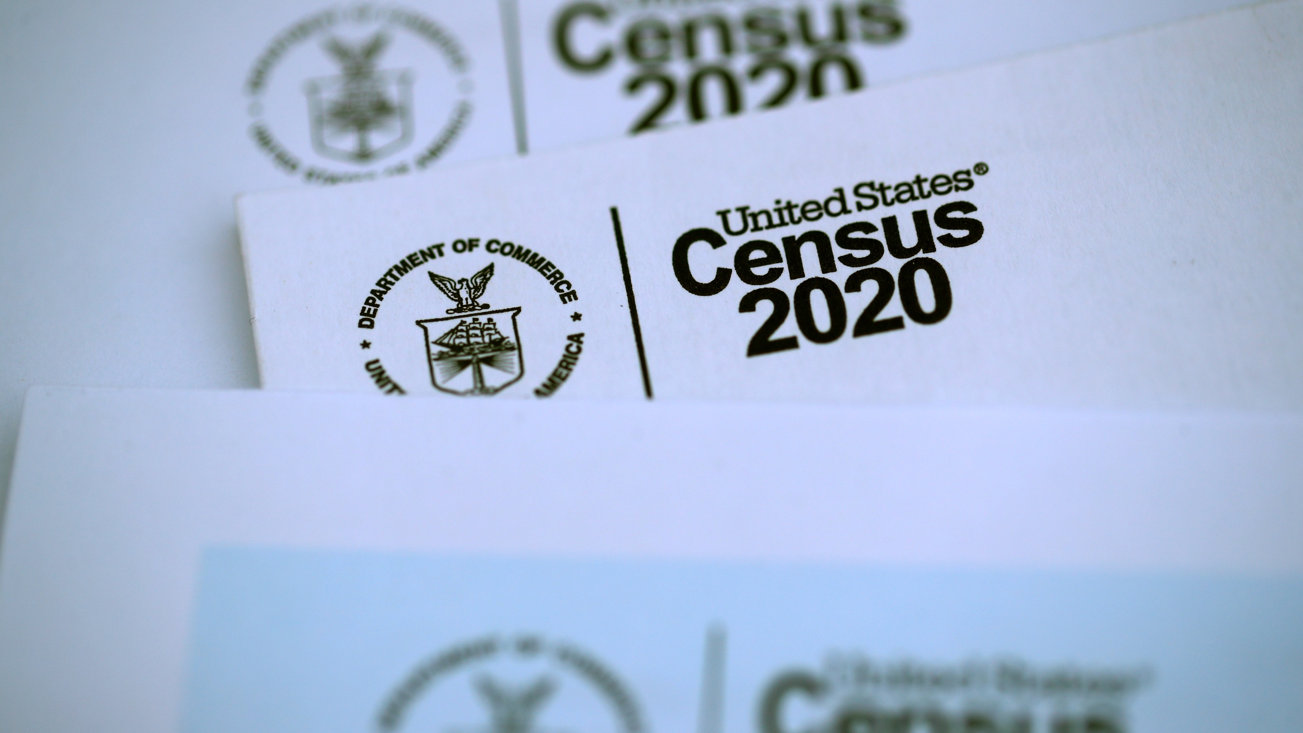 The U.S. Census logo appears on census materials received in the mail with an invitation to fill out census information online on March 19, 2020 in San Anselmo, California. (Justin Sullivan/Getty Images)