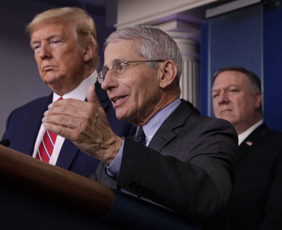 Dr. Anthony Fauci,director of the National Institute of Allergy and Infectious Diseases, speaks while President Donald Trump and Secretary of State Mike Pompeo listen during a briefing on the latest development of the coronavirus outbreak in the U.S. in the James Brady Press Briefing Room at the White House March 20, 2020. (Alex Wong/Getty Images)