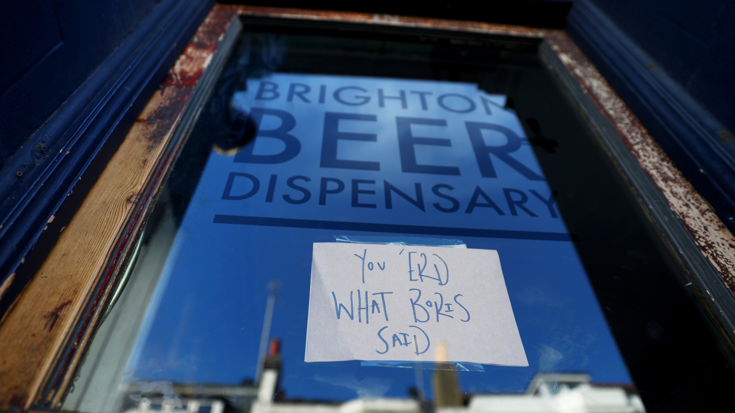 "A sign on the front door of the Brighton Beer Dispensary displaying the message ""You 'erd what Boris said"" informs customers that the pub has closed on March 23, 2020 in Brighton, United Kingdom. (Dan Istitene/Getty Images)"